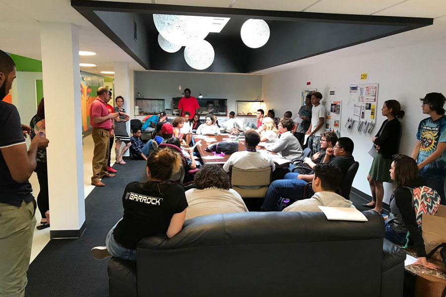 large group meeting with students and teachers