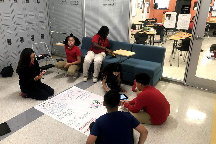 sixth graders completing a project