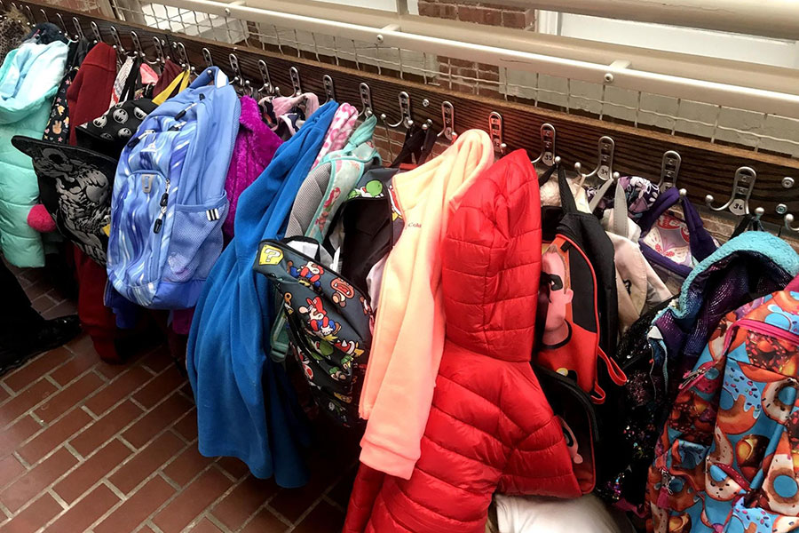 coats and lunchboxes in hallway