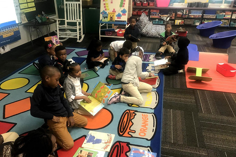first graders reading on rug