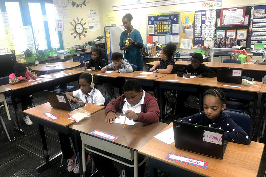 third graders working on laptops