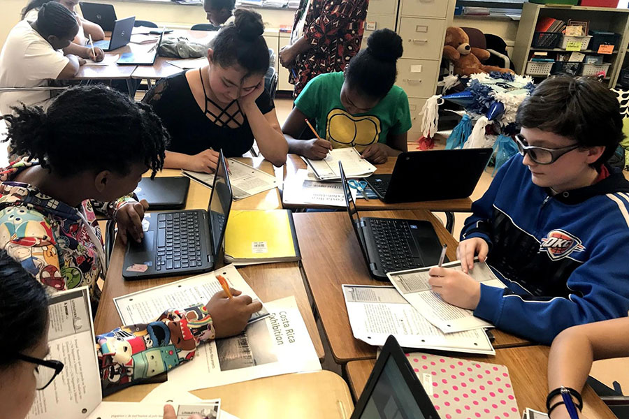 eighth graders working on project