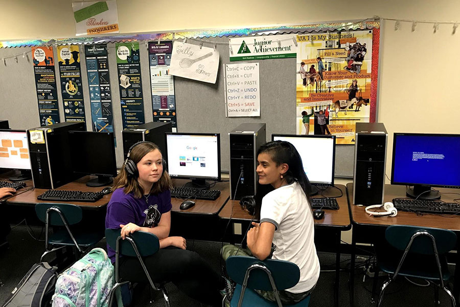 two girls in computer class