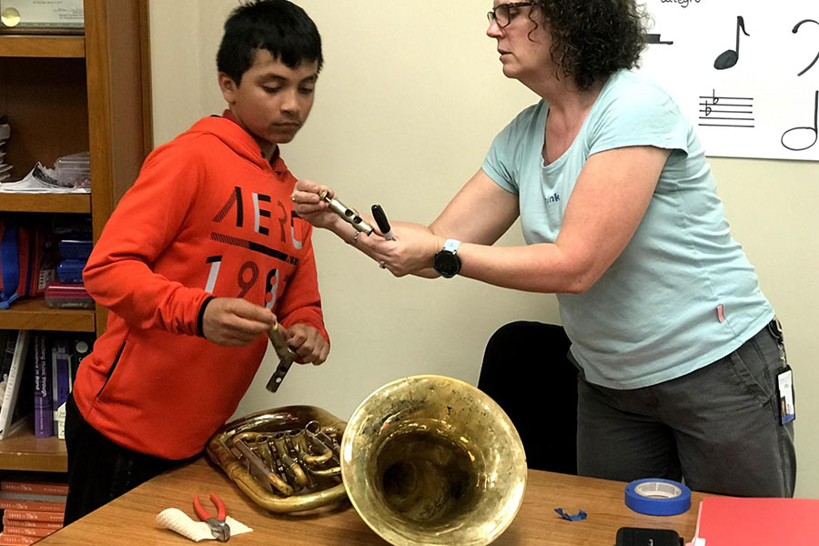 teacher and student with tuba