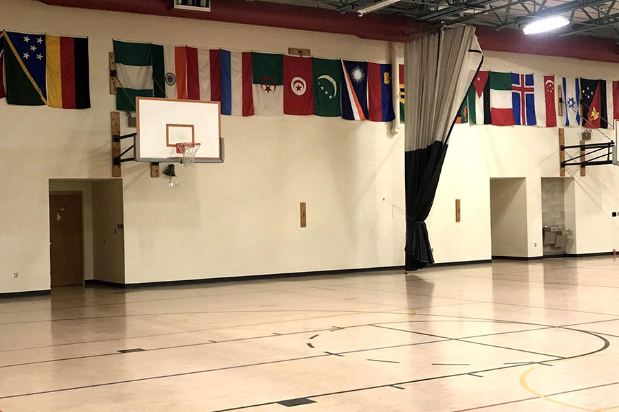 empty gym with basketball court