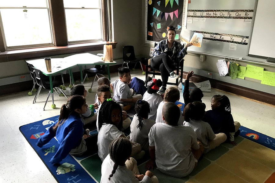 second graders on rug listening to a book