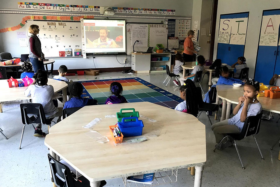 second graders listening to a story