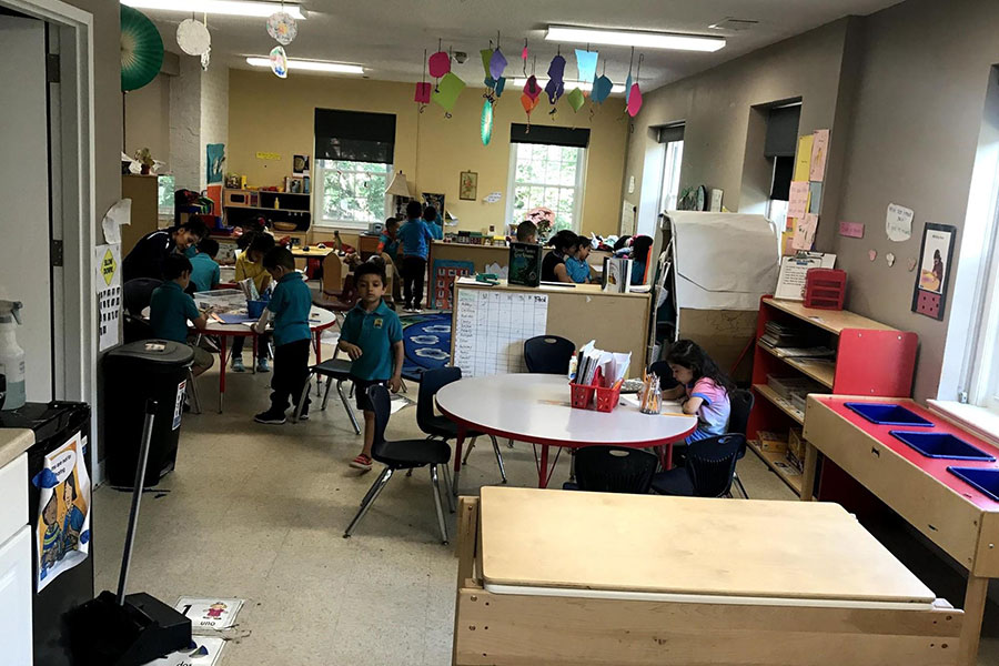 pre-k students cleaning up
