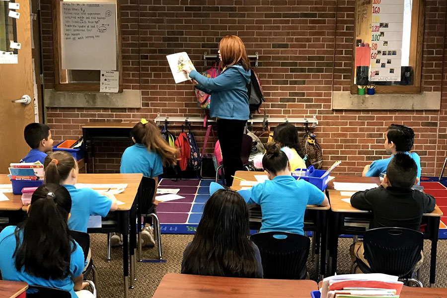 first graders reading a book aloud