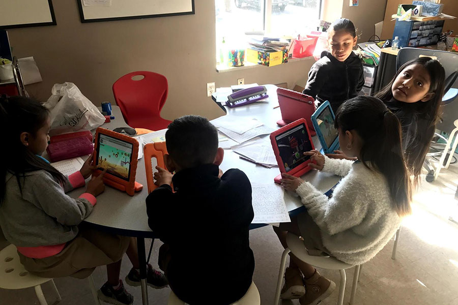 second graders playing games on ipads