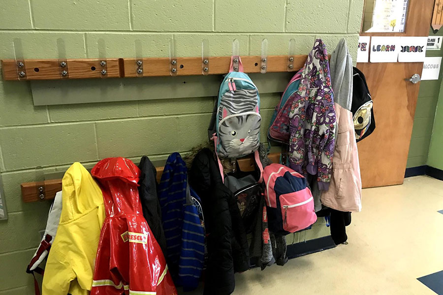 book bags and coats in hallway