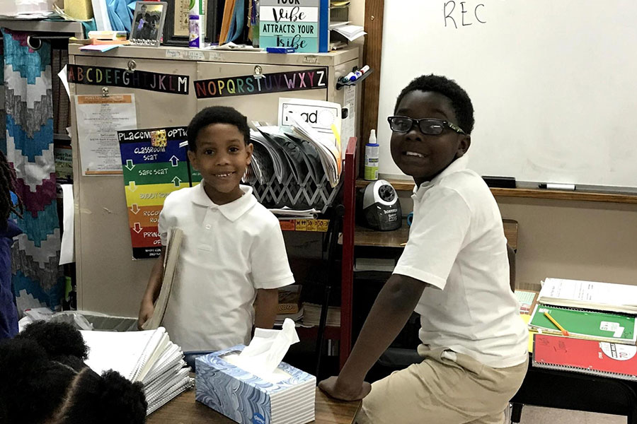 students in uniforms working together
