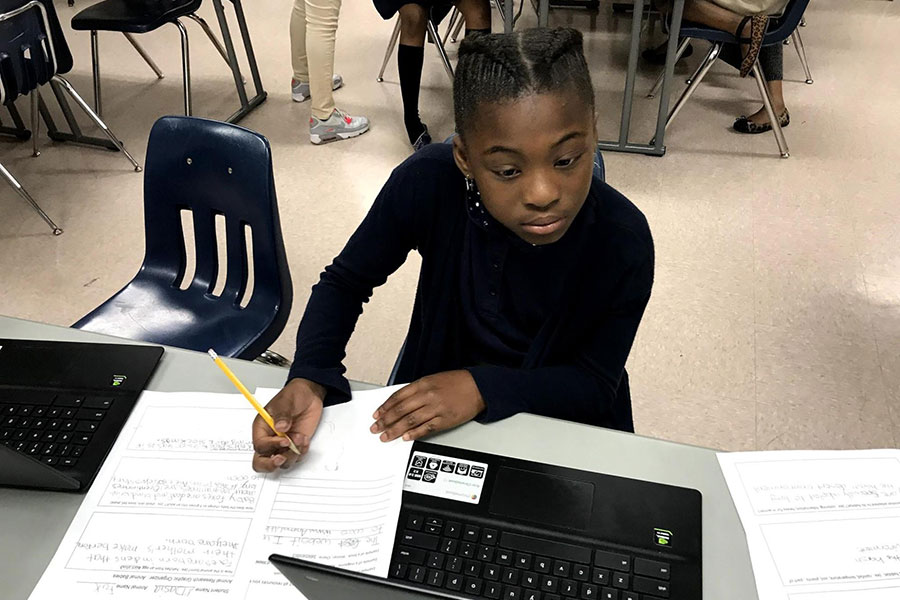 fifth grader working on laptop