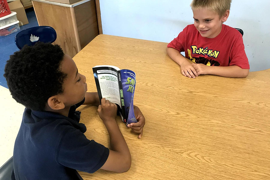 Students reading together.