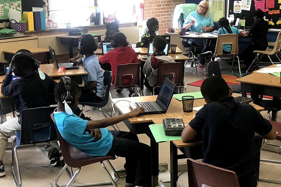 Fourth grade students playing computer games to work on reading skills.