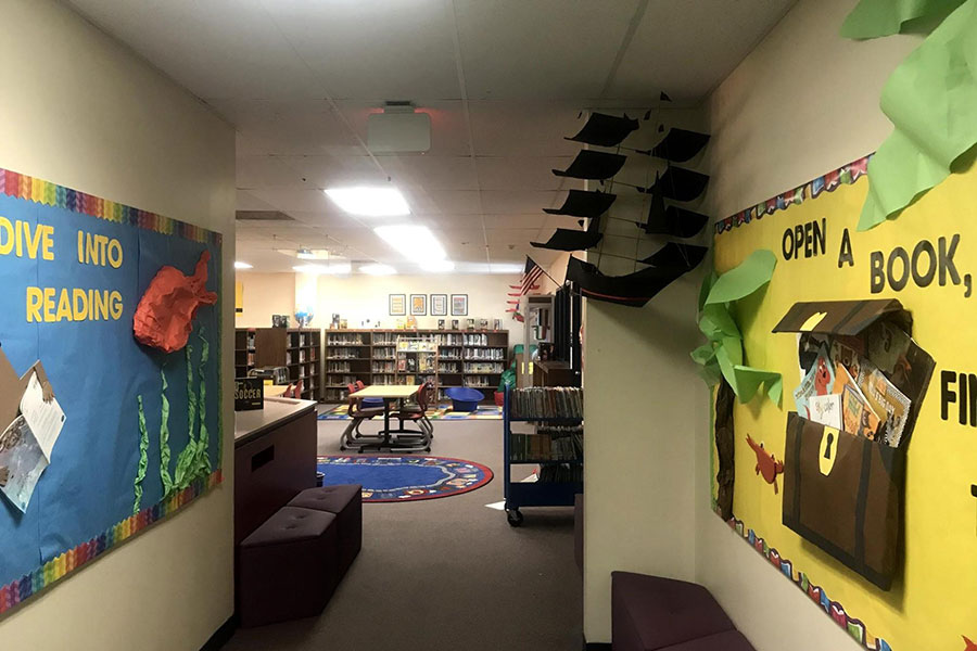 Melcher elementary school library with colorful artwork.