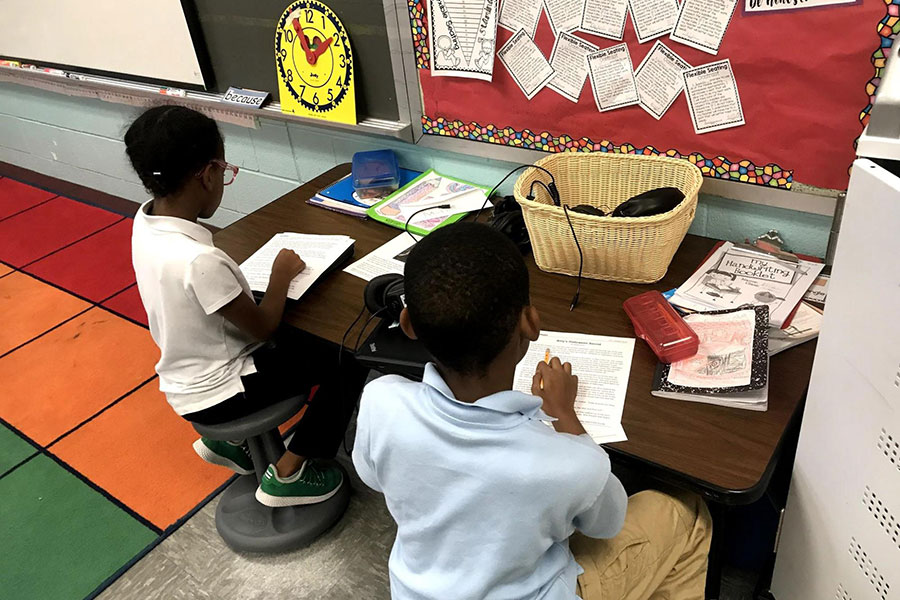 These two third grade students work in a pair to complete a math assignment.