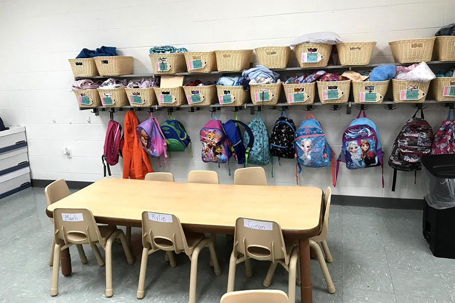 Bins and hooks for backpacks and blankets in the pre-K class.