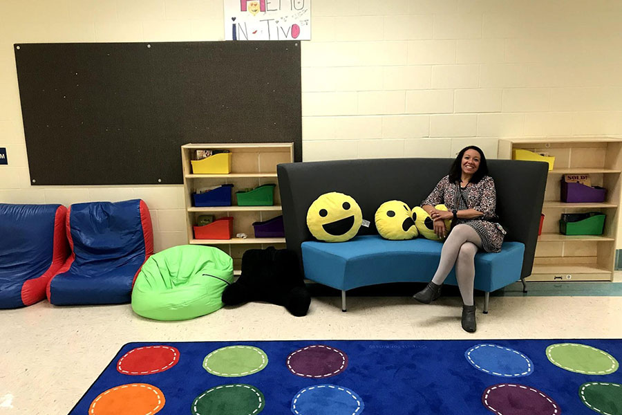 Principal sitting in upper elementary seating area