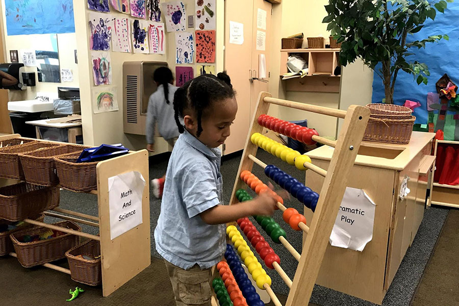 Student using abacus to practice counting