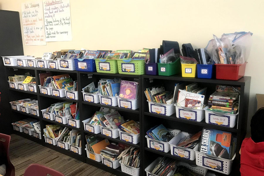 In every classroom are libraries like this one where students can select a book at their reading level.