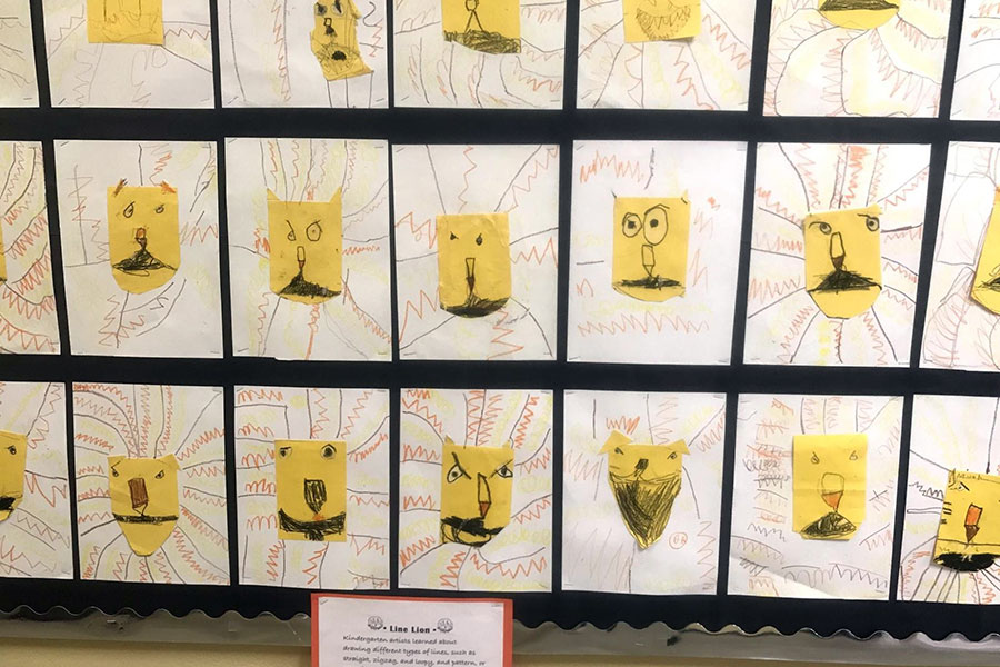 Kindergarten student artwork on display in the hallway.