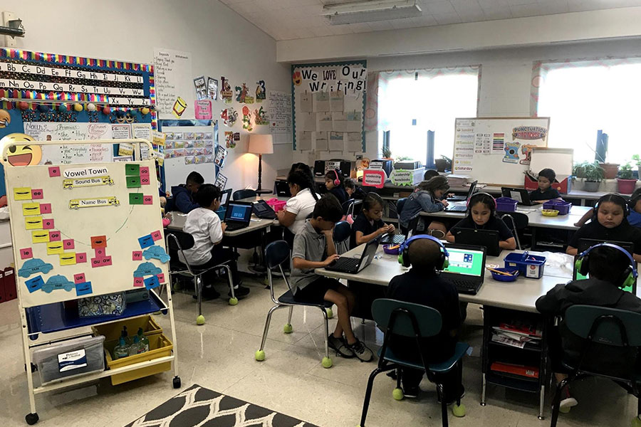 In second grade, students are working online to build their vocabulary.