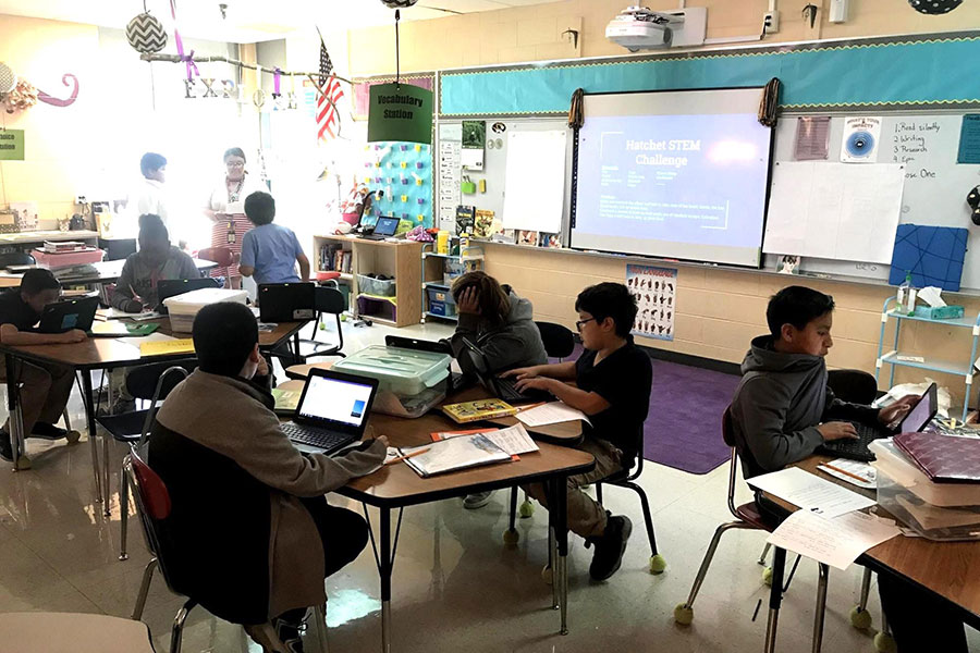 In this sixth grade classroom, students are completing a STEM challenge with their teacher.
