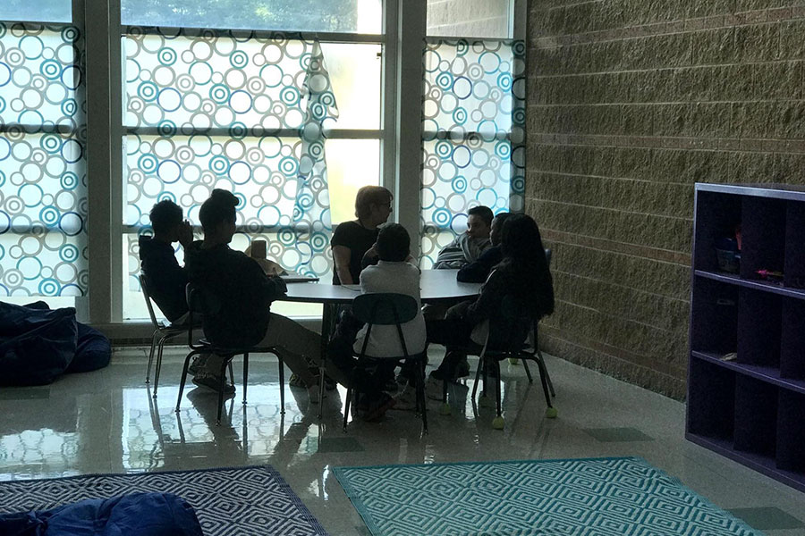 Students meet with support staff for extra help.