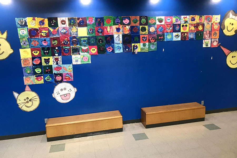 Mural of student artwork in a hallway.