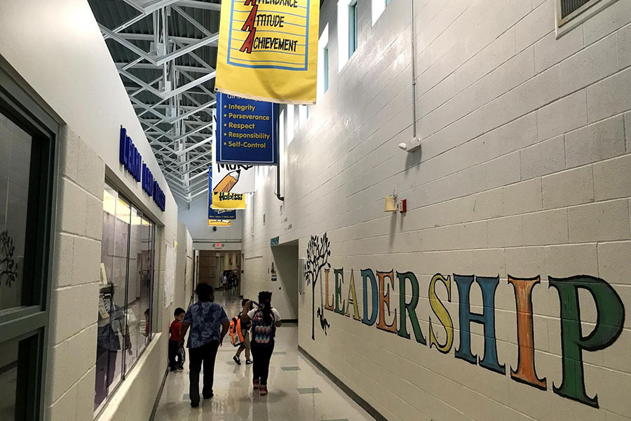Hallway with banners and murals