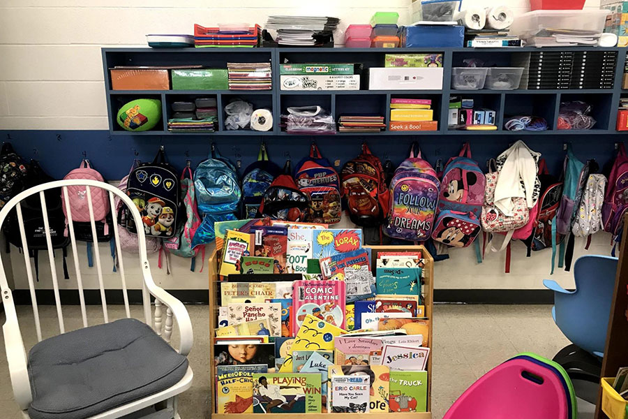 Classroom library and hooks for hanging coats and backpacks.