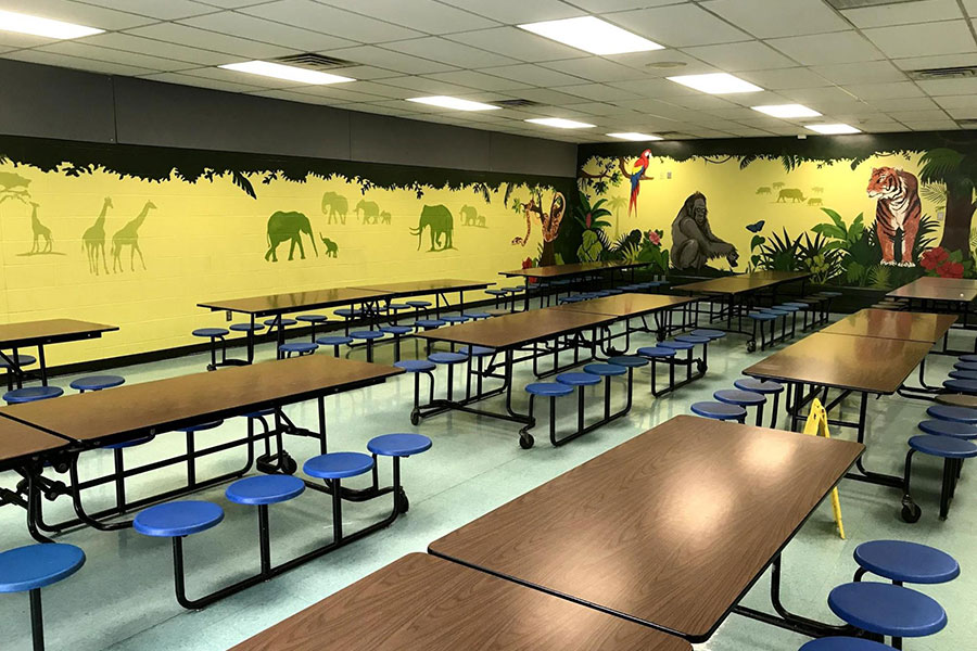 school cafeteria with jungle painted walls