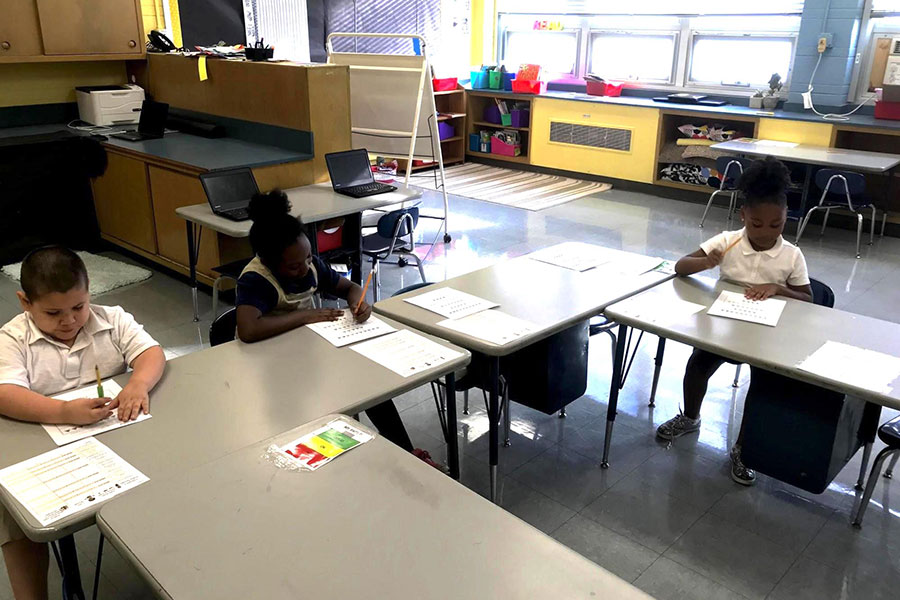students completing writing exercise