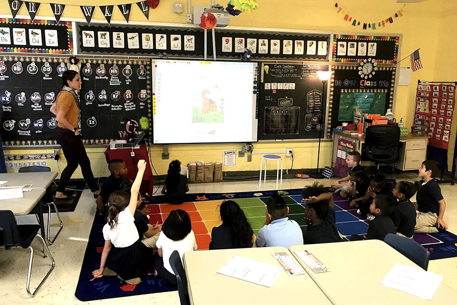students reading with class