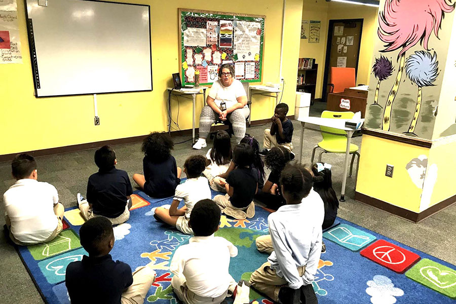 students listening to librarian