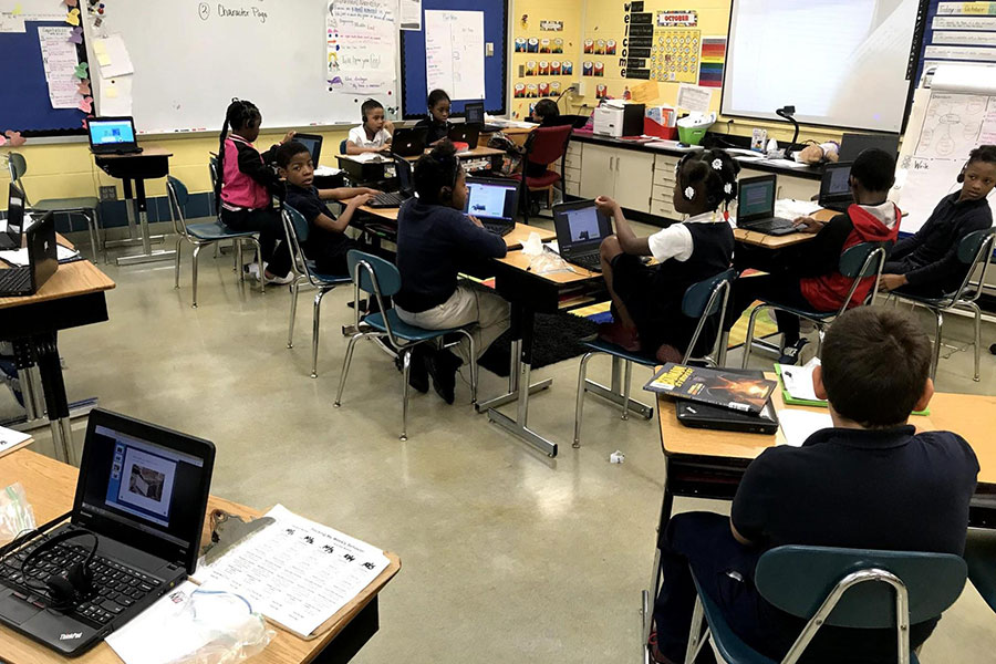 students using computers to practice reading