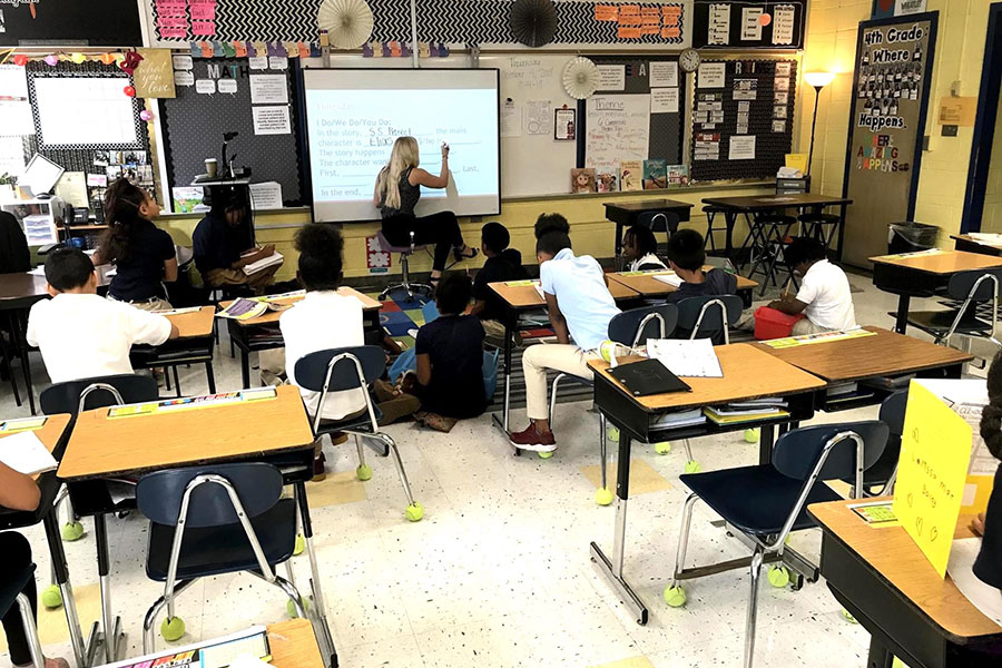 fifth grade students in classroom