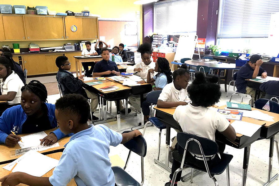 fifth grade students in small groups