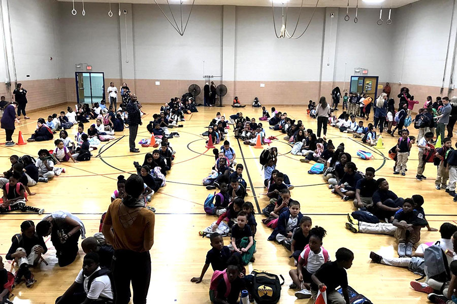 students in assembly in the gym