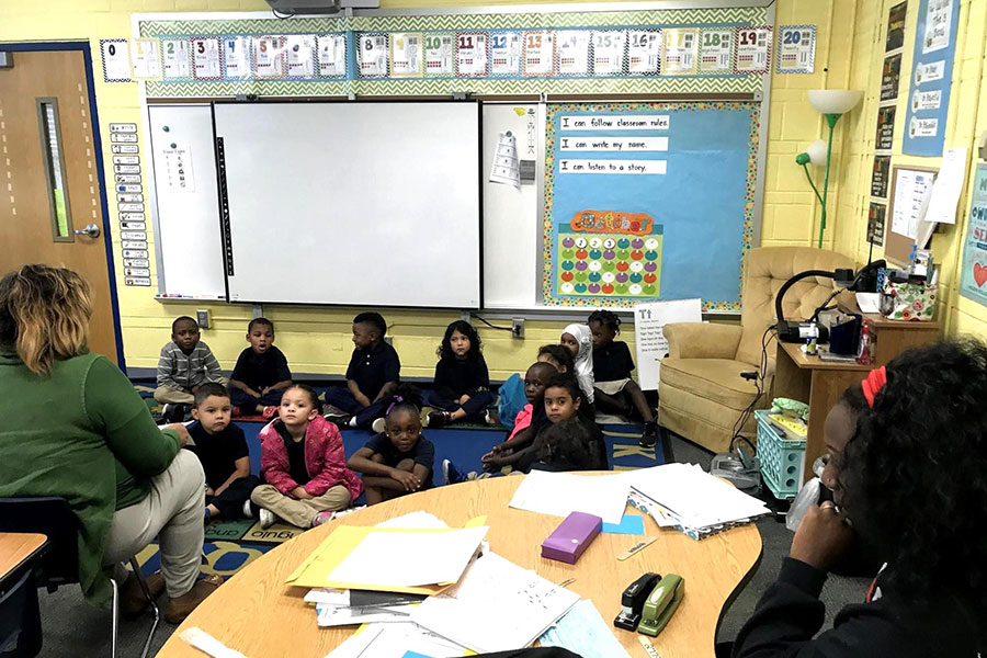 parent sitting in on classroom