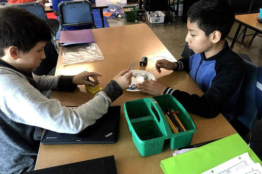 students completing science experiment