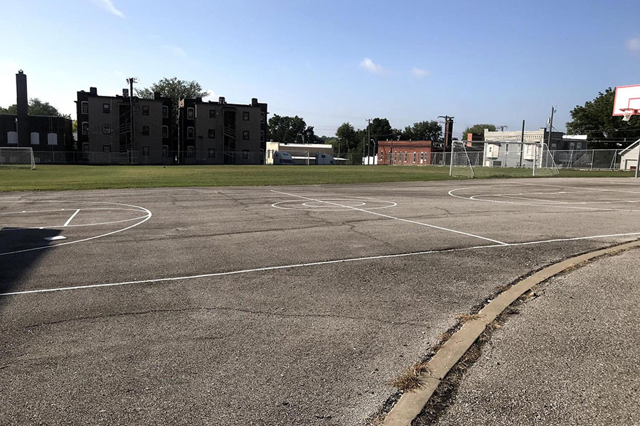 Large blacktop and greenspace area